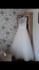 Wedding dress. Brand new. Never been worn, still with tags