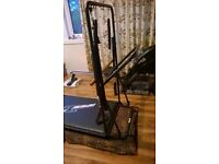 PILATES SUPREME MACHINE WITH 3 DVDS IMMACULATE CONDITION folds for storage & has wheels DELIVERY