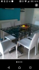 Black dinning table with 6 white chair