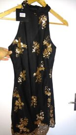 With label. 8 size woman dresses. 4 dresses.