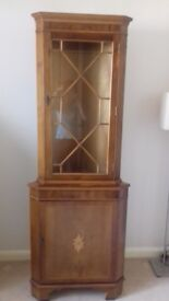 Corner cabinet approx 450mm wide by 1800 tall in a light coloured Yew vineer.