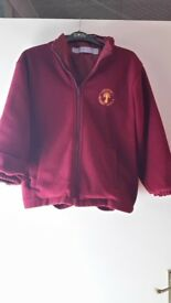 Lunsford Primary School red reversible jacket . For age 7-8