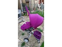 Purple stokke xplory pushchair