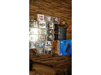 Ps3 very good condition with 2 controlers, 18 games and wireless headset