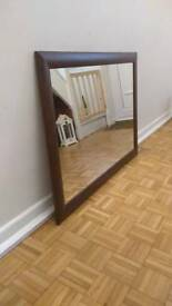Large, wooden framed mirror