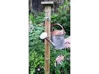 garden vintage brass tap wood post hanger for cans or bucket for garden decoration.