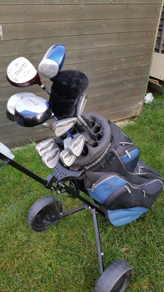 Golf clubs shoes trolley and bag