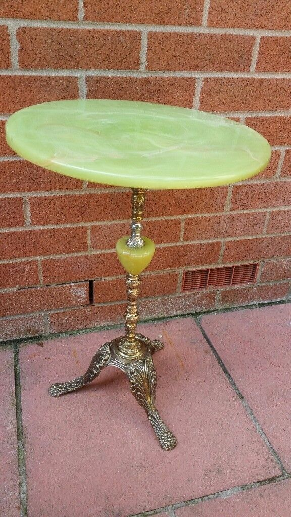 coffee decorative table with stone top!in very good condition for the age!can deliver or post!