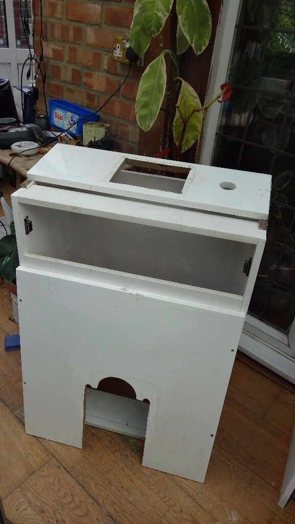 A 500mm White high gloss toilet cabinet has got hole cut on the side and bottom ready to fit cost