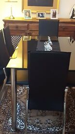 Brand new black glass dinning with 6 chairs