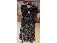 Yours brand new with tags dress size 16!