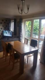 Solid oak Wooden table and 4 chairs