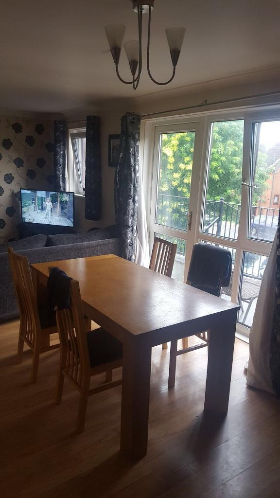 Solid oak Wooden table and 4 chairs good condition