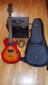 Electric guitar, amp, case and lead.