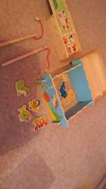 Wooden toys dominoes and fishing games