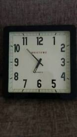Quartz clock with glass frame
