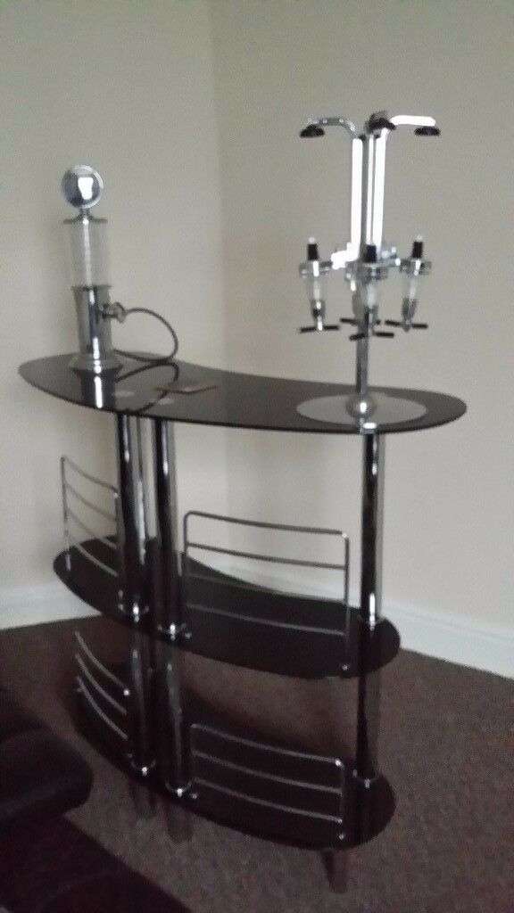 Home nlack glass bar with x2 black leather swivel gas stools