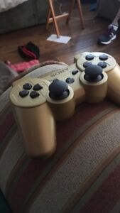 Barley used gold PS3 controller