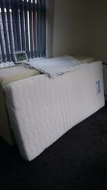 Single bed with memory foam mattress and mattress protector