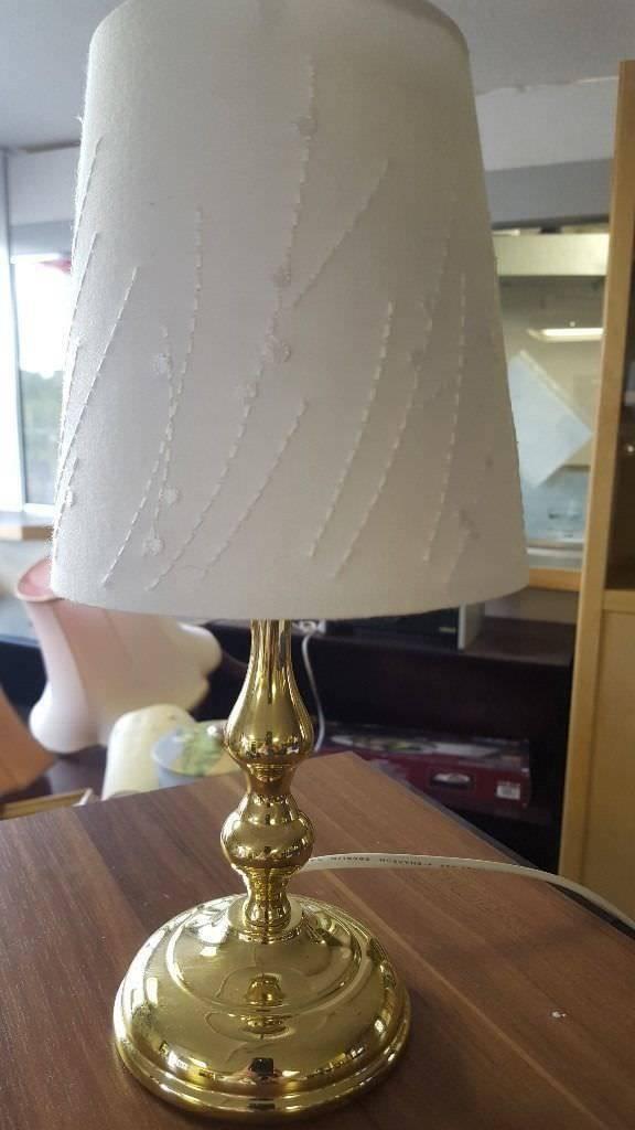 Quaint little brass lamp with modern shade