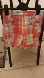 Girls check orange shorts age 7-8