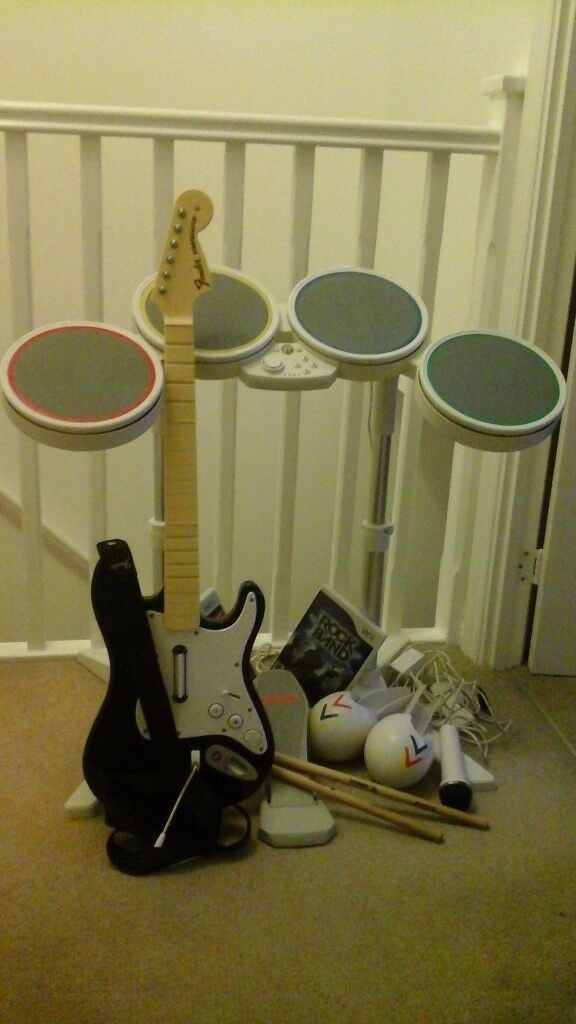 Nintendo wii Rock Band, guitar, drums, mic, maracas & game @ £50 ono - call Maxine on 07901-863412