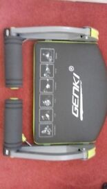 Wondercore by Genki. Helps tone core, legs and arms while supporting back. Adjustable resistance.