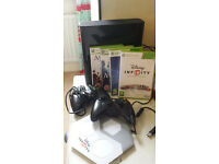 Selling my XBOX360 plus controllers and games: Assassins Creed and Disney Infinity