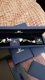 Swarovski charm bracelet like new only worn once