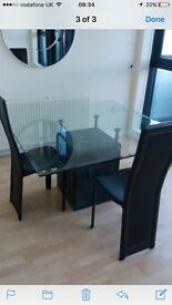 Glass and marble dining room table