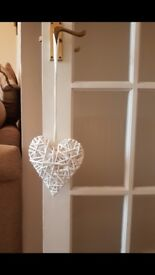12 White wicker heart decorations with white ribbon