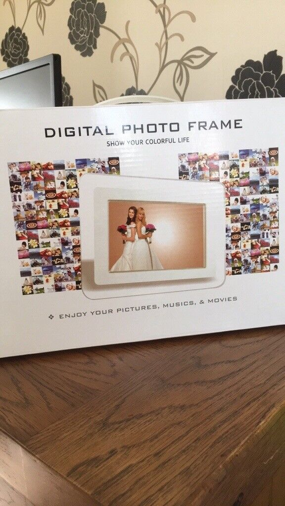 Digital photo frames including built in speakers for music and movies. Brand new still boxed