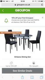 Black table glass and chairs for sale