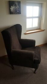 2 wingback armchairs in a brown material. Could be reupholstered if desired. Good condition.