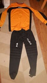 Goalkeeper top, trousers and shin pads.