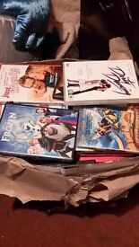 3 boxes of dvds various titles