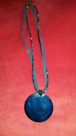 leather and beaded chain with shell necklace