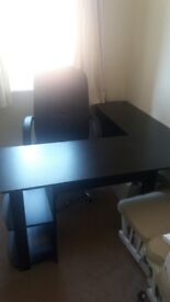 Black desk and leather chair