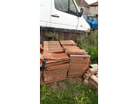 I have roughly about 90 roof tiles going for free to who ever can collect them