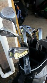 Golf clubs in bag with trolly