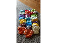 25 reusable fuzzibunz elite birth to potty nappies including liners and washing bag.