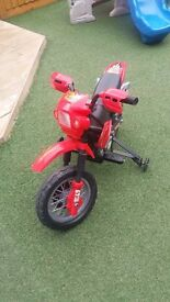 Great condition kids electric ride on motorbike with stabilisers