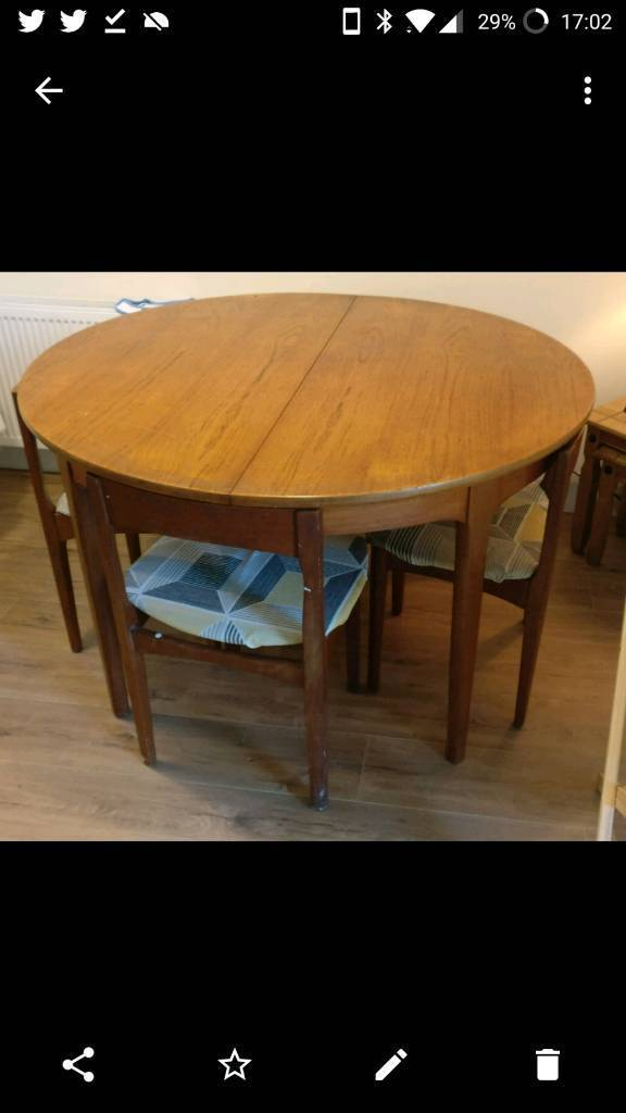 Scandinavian extending circular dining table with 4 chairs