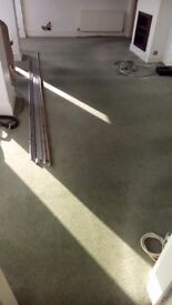 Green carpet with underlay.