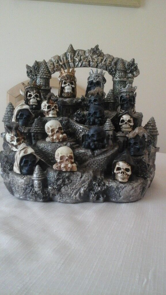 Nemises Skull Castle stand and skulls