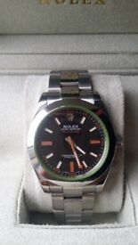 rolex milgauss black face orange sweeping hand, sapphire glass, waterproof, oyster folding clasp