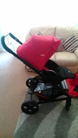 Joie chrome buggy and carrycot red