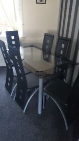 Black & Sliver Glass Table & 6 Leather Chairs