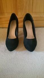 Women's suede look black heels. Size 7.