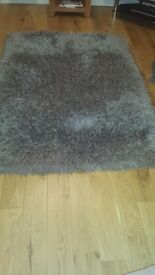 For sale a next grey sparkle rug in good condition no pets or children